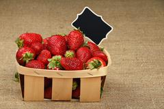 Strawberry in basket with price sign on canvas - stock photo