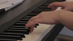 Woman hands playing the piano, close-up - stock footage