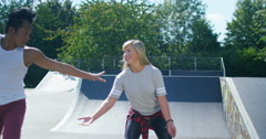4K Young urban street dancers showing off some moves at skate park - stock footage