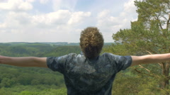 Looking over the world with joy raising arms happy succes beautiful 4K Ultra Stock Footage