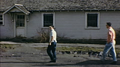 USA 1950s: boys walking in a residential area Stock Footage