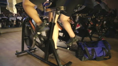 Spinning class trainers in the dark Stock Footage