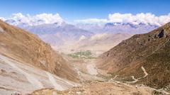 Annapurna Circuit Trek, Nepal - View to Muktinath After Thorung la Pass - stock footage