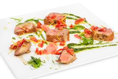 veal medallions with pesto sauce - stock photo