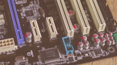 slider shots of the surface of computer hardware parts, chips,motherboard - stock footage