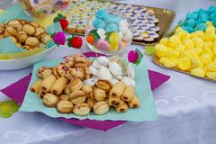 Sweets and cakes on party table Stock Photos