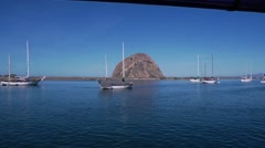 Morro Rock with boats Stock Footage