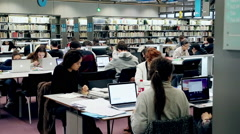 Students are learning in the library - stock footage