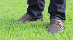 Boots brown on green grass Stock Footage