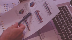 Man at work in the evening, home office, analyse expenses figures on pie charts Stock Footage