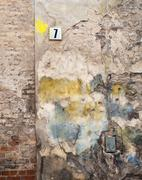 Colorful brick wall and plate with a number seven Stock Photos