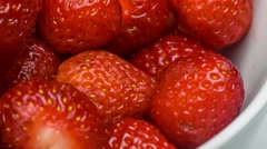 Lot of fresh strawberries pile. Rotating, turntable. (BMCC 2.5K - 2400x1350) Stock Footage