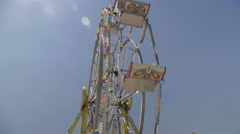 Ferris Wheel in amusement park by the lake. Sunny and blue sky summer day. 4K - stock footage