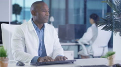 4K Scientist in white coat using interactive touch screen in modern lab Stock Footage