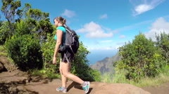 CLOSE UP: Woman walking along the jungle mountain path in sunny Hawaii - stock footage