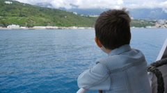 The boy on the ship in windy weather - stock footage