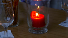Candle burning in a glass Stock Footage