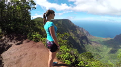 Young woman admiring stunning view on the top of the jungle mountain - stock footage