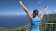 CLOSE UP: Happy girl admiring stunning view and outstretching arms proudly - stock footage