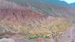 Aerial video of uranium deposits in red rocks. Kyrgyzstan - stock footage