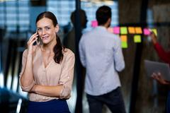 Focus on foreground of businesswoman calling - stock photo