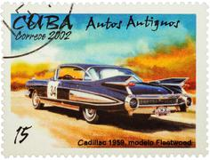 Old car Cadillac Fleetwood (1959) on postage stamp Stock Photos