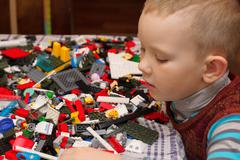 Boy plays with constructor - stock photo