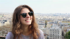 Smiling girl in a summer day in Montmarte in Paris Stock Footage