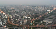4K Sunset Time lapse Aerial view express way busy Bangkok city rush hour Stock Footage