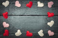 Red hearts on the dark boards - stock photo