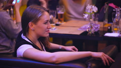 Nice girl in a nightclub restaurant spending time with friends Stock Footage