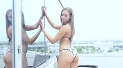 Sexy bikini girl on balcony in silver swimsuit - Miami Stock Footage