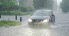 Extreme rain in netherlands street with car driving, 4K Stock Footage
