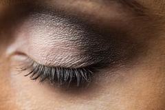 Focus on eyes makeup with closed eyes - stock photo