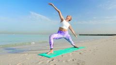 Young girl doing Vinyasa yoga poses Stock Footage
