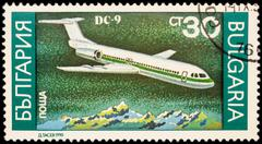 Passenger aircraft Douglas DC-9 on postage stamp Stock Photos