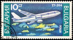 Passenger aircraft Tupolev Tu-204 on postage stamp Stock Photos