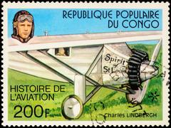Charles Lindbergh and his plane Spirit Of Saint-Louis (1927) on postage stamp - stock photo