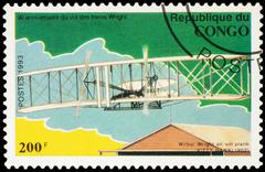 Flight Wilbur Wright at Kitty Hawk glider in 1902 on postage stamp - stock photo