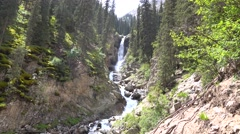 4K video of high waterfall in mountain spruce forest. Kyrgyzstan - stock footage