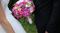 Close up portrait of happy wedding couple holding pink bridal bouquet and gently Stock Footage