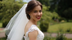 Close up of smiling bride wearing white dress and veil with bright makeup - stock footage
