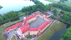 Aerial View. Flying over the castle's old town at sunset with sun rays. - stock footage