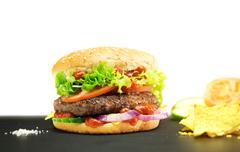 Hamburger - homemade burger with fresh vegetables - stock photo
