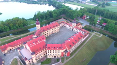 Aerial View. Flying over the castle's old town at sunset with sun rays. Stock Footage