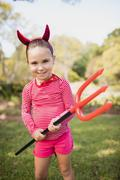 Little girl standing and dressing up as devil - stock photo