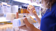 Woman Buying Body Care Products in Supermarket - stock footage