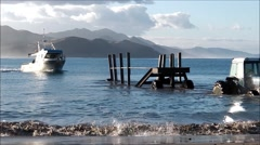 Fishing boat approaches submerged trailer. Arkistovideo
