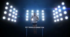 Sportsman is practising hurdles Stock Footage