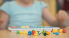 Little girl plays a intellectual educational game - stock footage